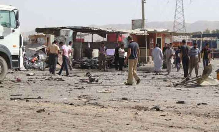 two killed 11 injured in iraq attacks