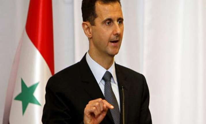 us uk back down from immediate strike assad vows victory