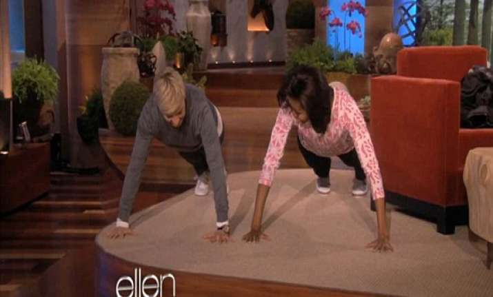 us first lady michelle obama does 25 push ups inside tv