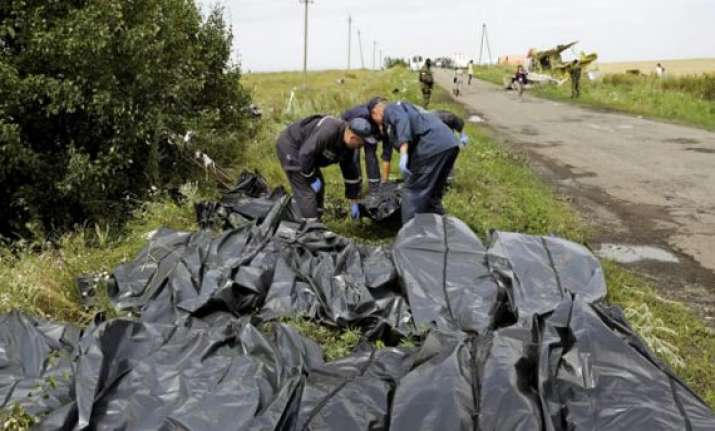 ukrainian investigators found 196 bodies at mh17 crash site