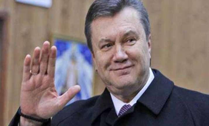 ukrainian president calls truce with opposition