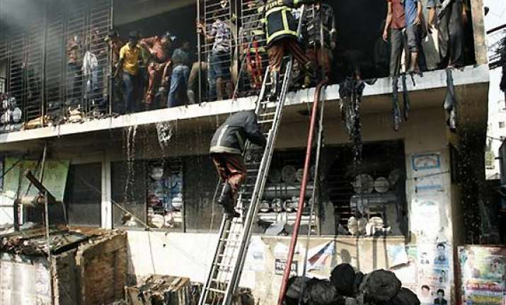 wal mart distances itself from garment factory fire in