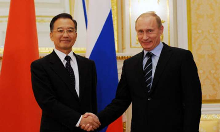 wary about us moves china russia pledge to prioritise ties