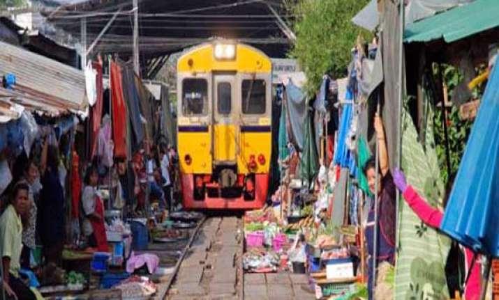 watch in pics bizarre market in vietnam where train runs