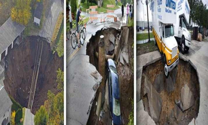watch in pics sinkholes across the world
