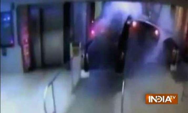 watch video of commuter train crashing onto platform in