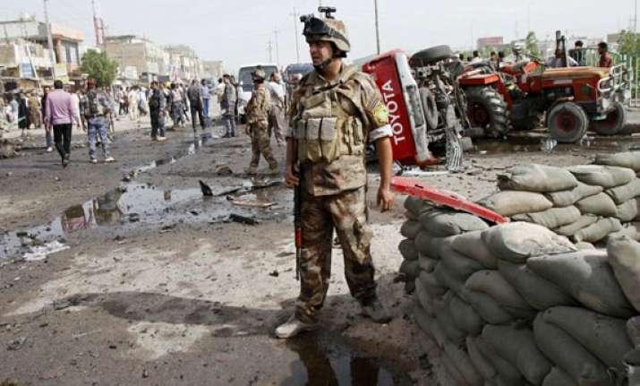 wave of attacks kills at least 57 in iraq