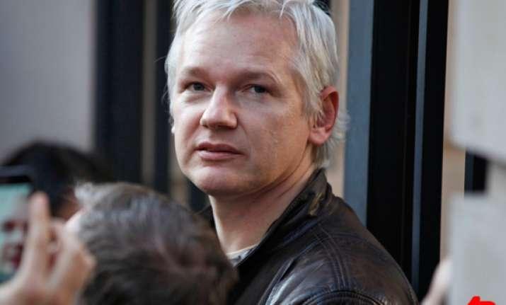 wikileaks defection reports false says assange