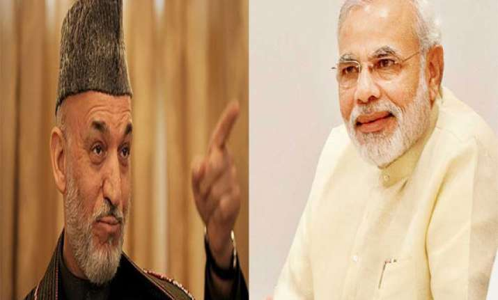 will protect indian missions karzai tells modi