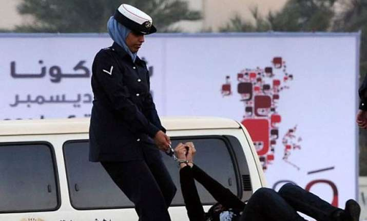 woman activist in bahrain handcuffed dragged hit by police