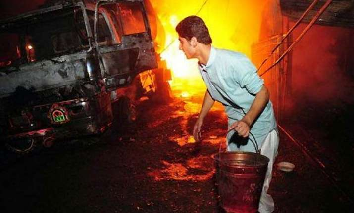 11 nato tankers set on fire in pakistan