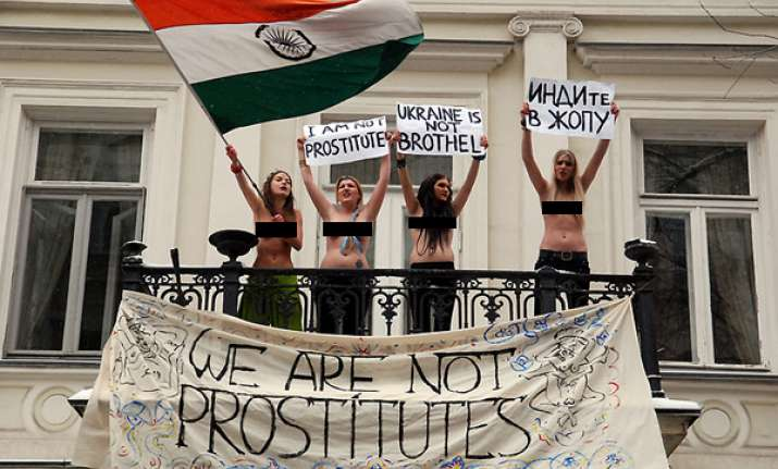 topless ukrainians may face jail for insulting indian flag