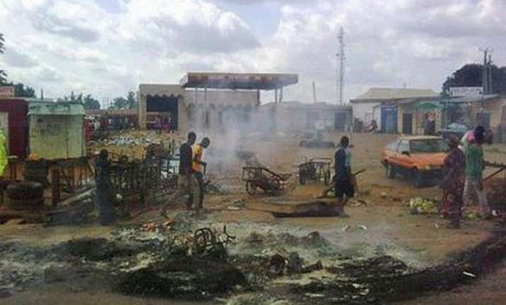 118 killed in nigerian twin blasts