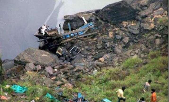 20 die as bus falls into gorge