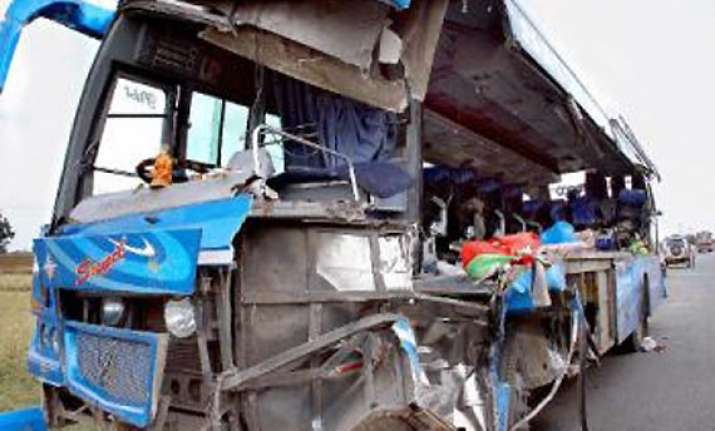 14 killed 23 injured as bus rams into truck