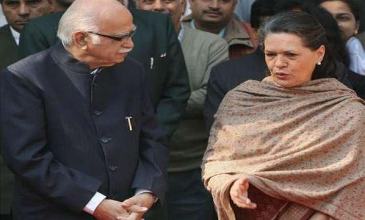 advani apologizes to sonia gandhi on swiss account issue