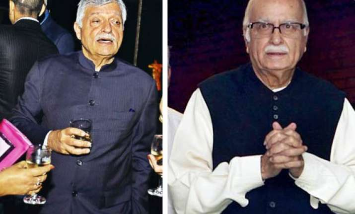 advani demands probe into satish sharma s role in cash for