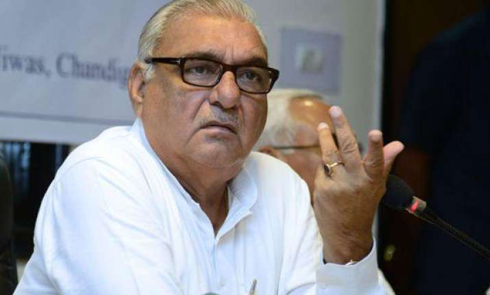 after congress rout haryana bjp demands hooda s resignation