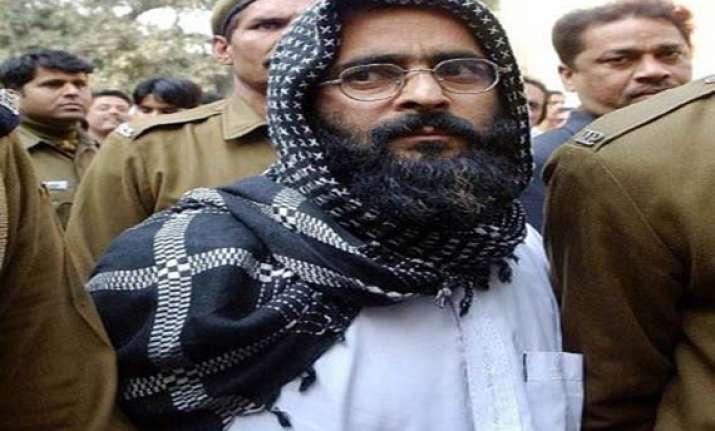 afzal guru s belongings to be returned to his family