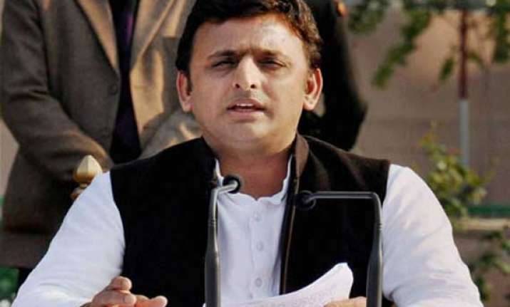 akhilesh defends vadra calls modi a model of dividing india