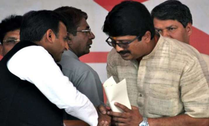 akhilesh to expand up cabinet raja bhaiya likely to get