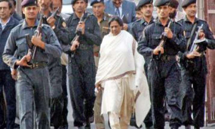 akhilesh reduces mayawati s security cover