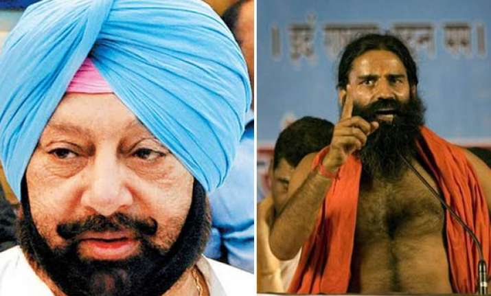 amarinder writes to himachal cm to revoke lease to ramdev