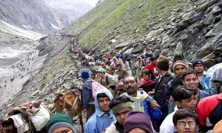 amarnath yatra begins in tight security inclement weather