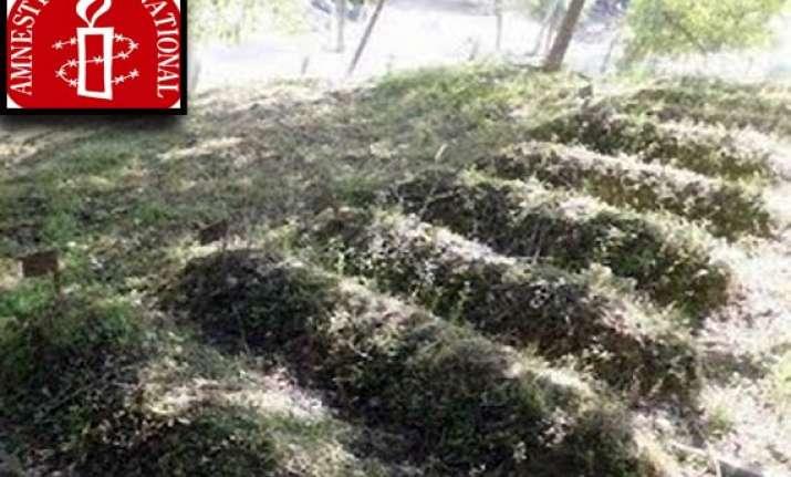 amnesty asks india to probe kashmir graves