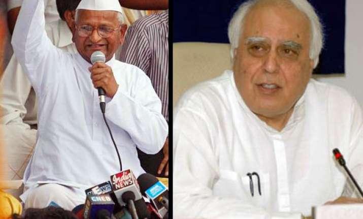 anna hazare demands sibal s resignation
