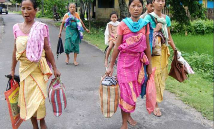 assam killings relatives agree to cremate baksa victims