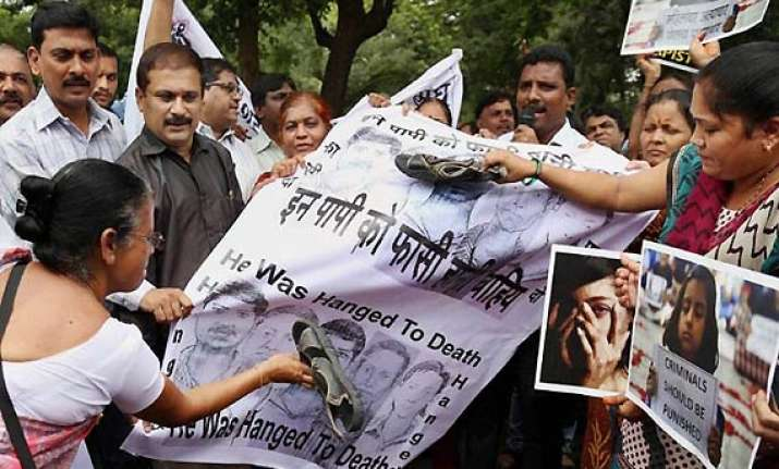 assam photo journalists protest against mumbai gang rape