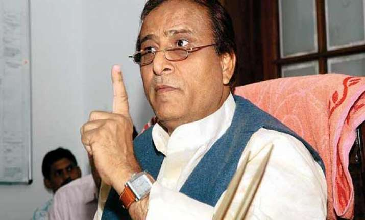 azam blames rss for up clashes