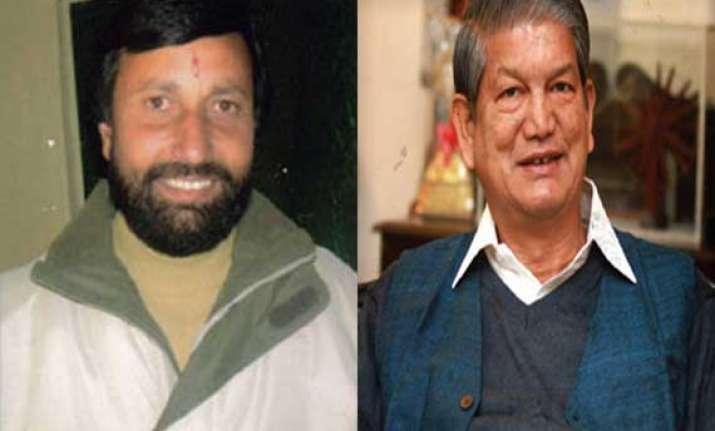 bjp demands action against uttarakhand cm for violating