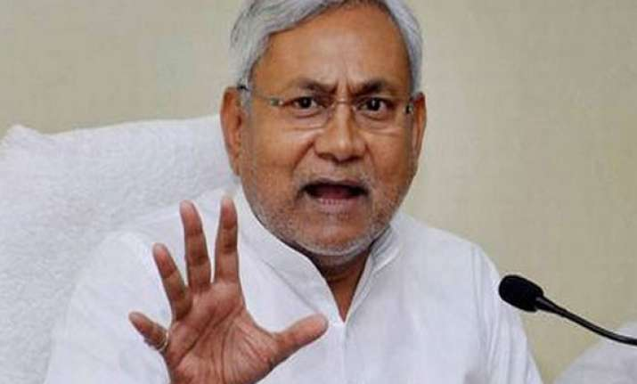 bjp seeks nitish s resignation after rout in general