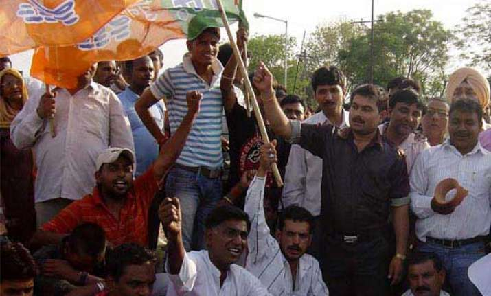 bjp workers protest denial of permission for modi s rally