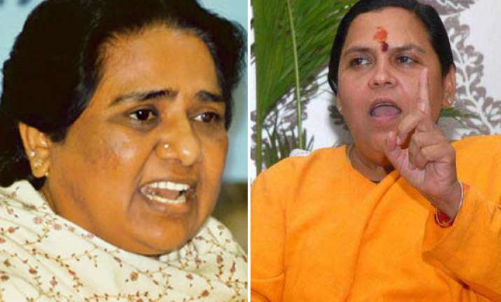 bjp accuses mayawati s brother of graft dares cong to probe