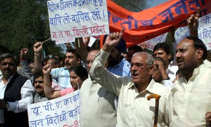 bjp activists hold protests against petrol hike
