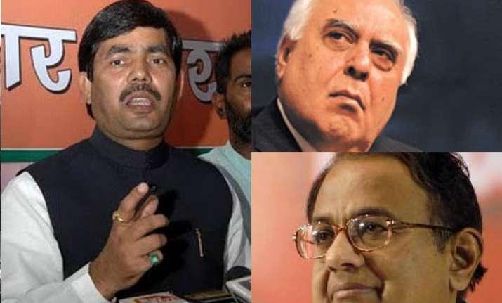 bjp asks pm to remove chidambaram sibal