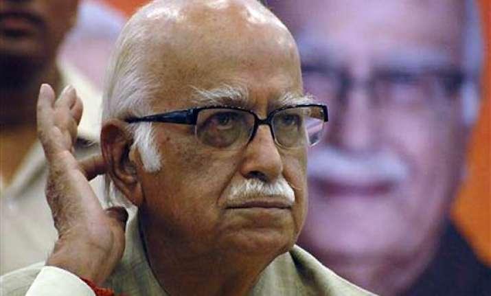 bjp distances itself from advani s comments against pm