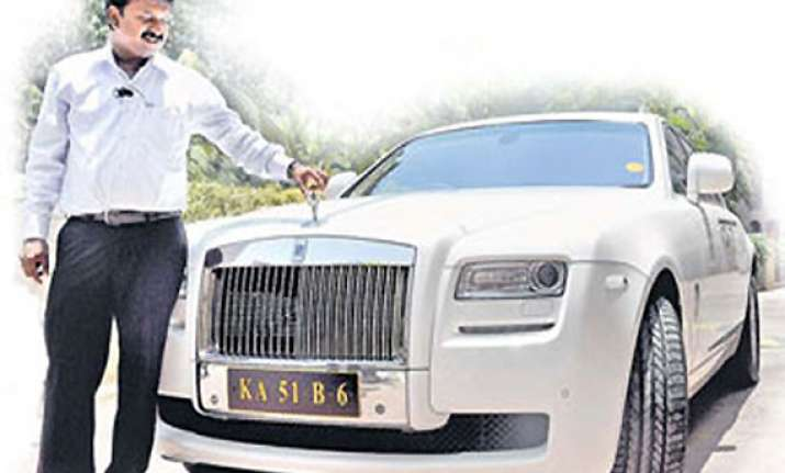 bangalore barber owns rolls royce ghost 67 other cars
