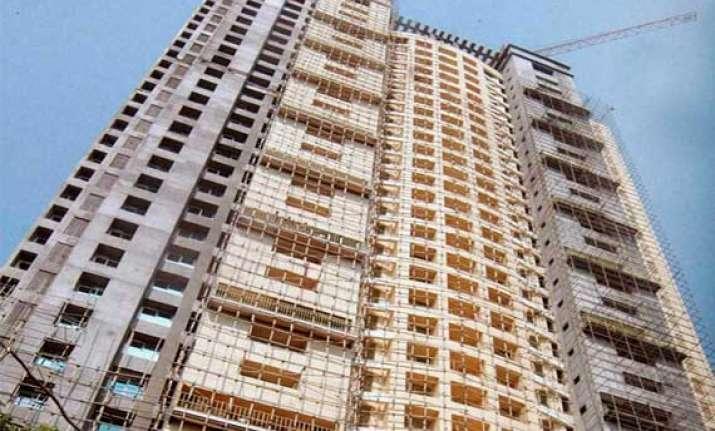 benami flats in adarsh were bought under sc/st quotas cbi
