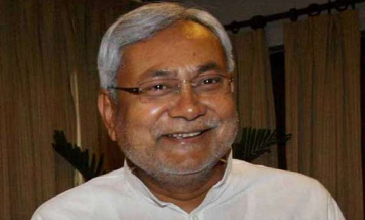 bihar bjp objects to nitish s photo in labour dept s booklet