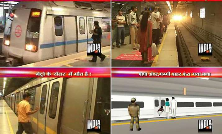 boy trapped in delhi metro doors mom falls on track