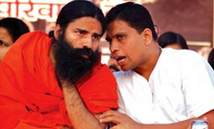 cbi books ramdev aide for forgery balkrishna alleges