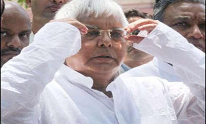cbi court frames charges against lalu 3 others in fodder