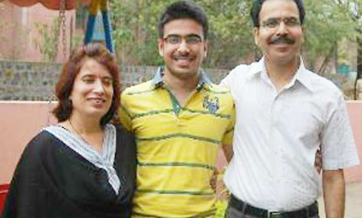 cbse results son tops xiith exam as father takes on naxals