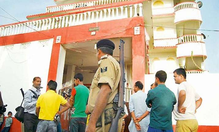 cash properties of over rs 5 cr seized in raids on 2