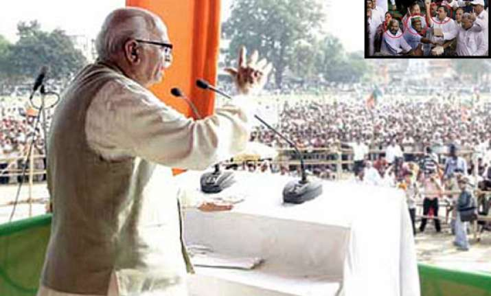 cash for vote scam advani demands release of party mps