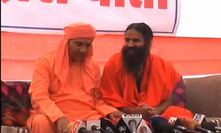 caught on camera ramdev discussing money with bjp candidate